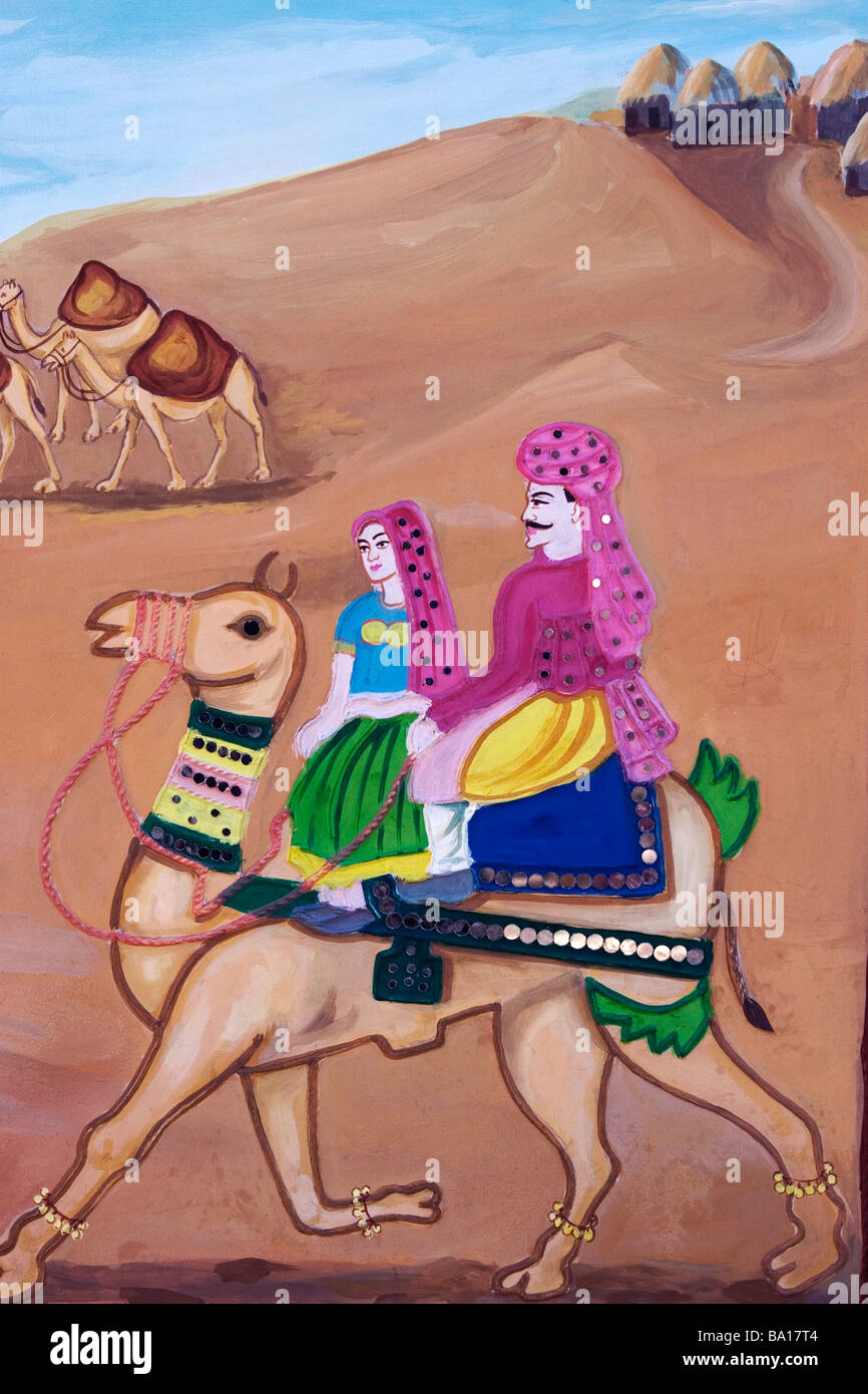 Indian Wall Painting depicting a man and woman in traditional Indian dress riding a camel in the desert - Stock Image