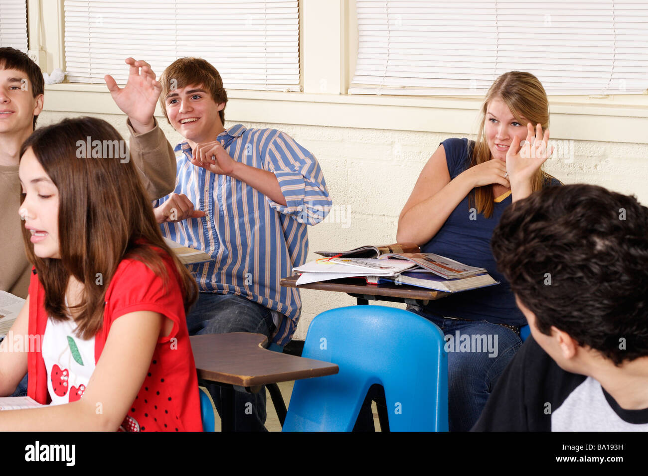 Students acting up in class throwing paper wads - Stock Image