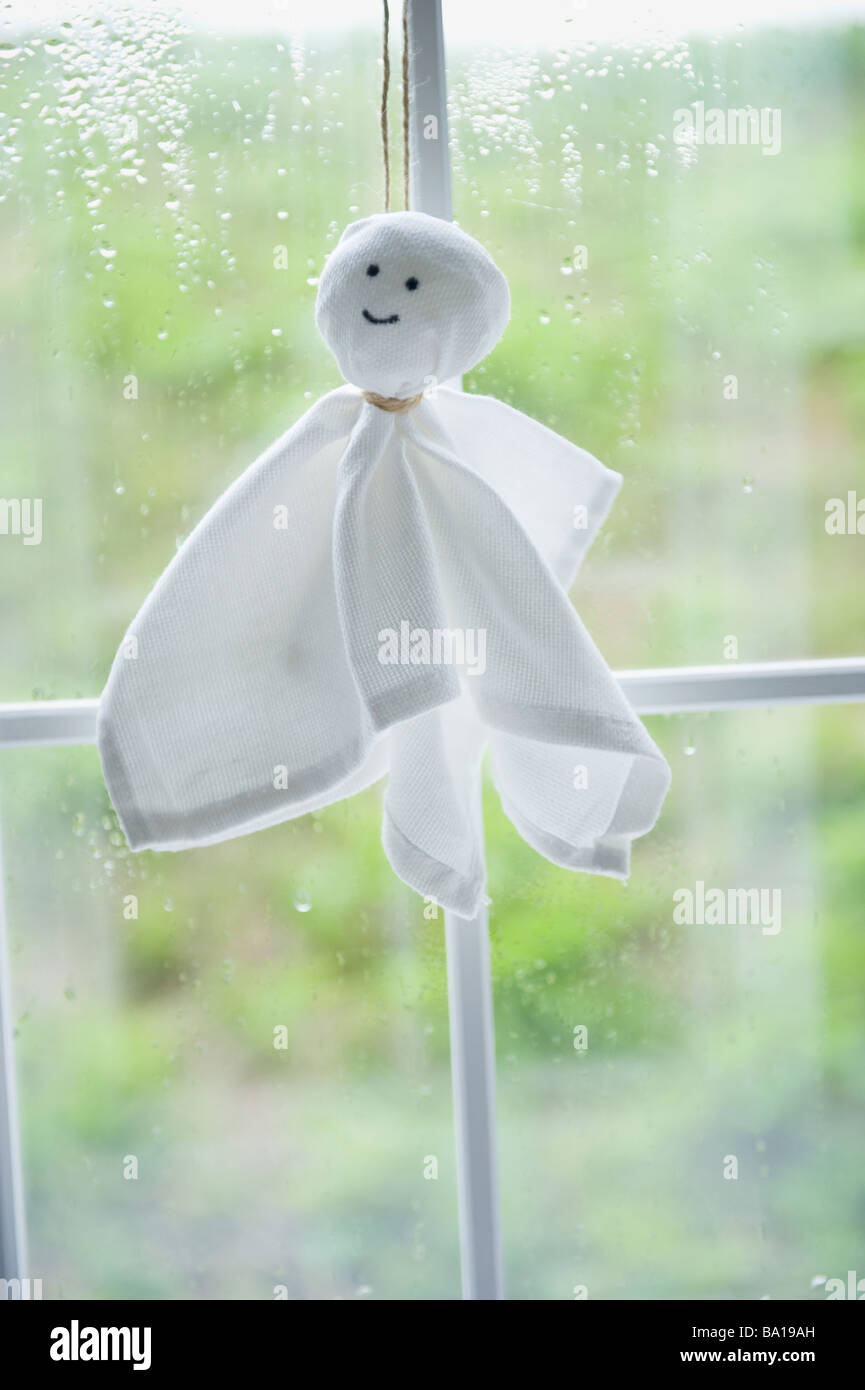 Paper doll for fine weather - Stock Image