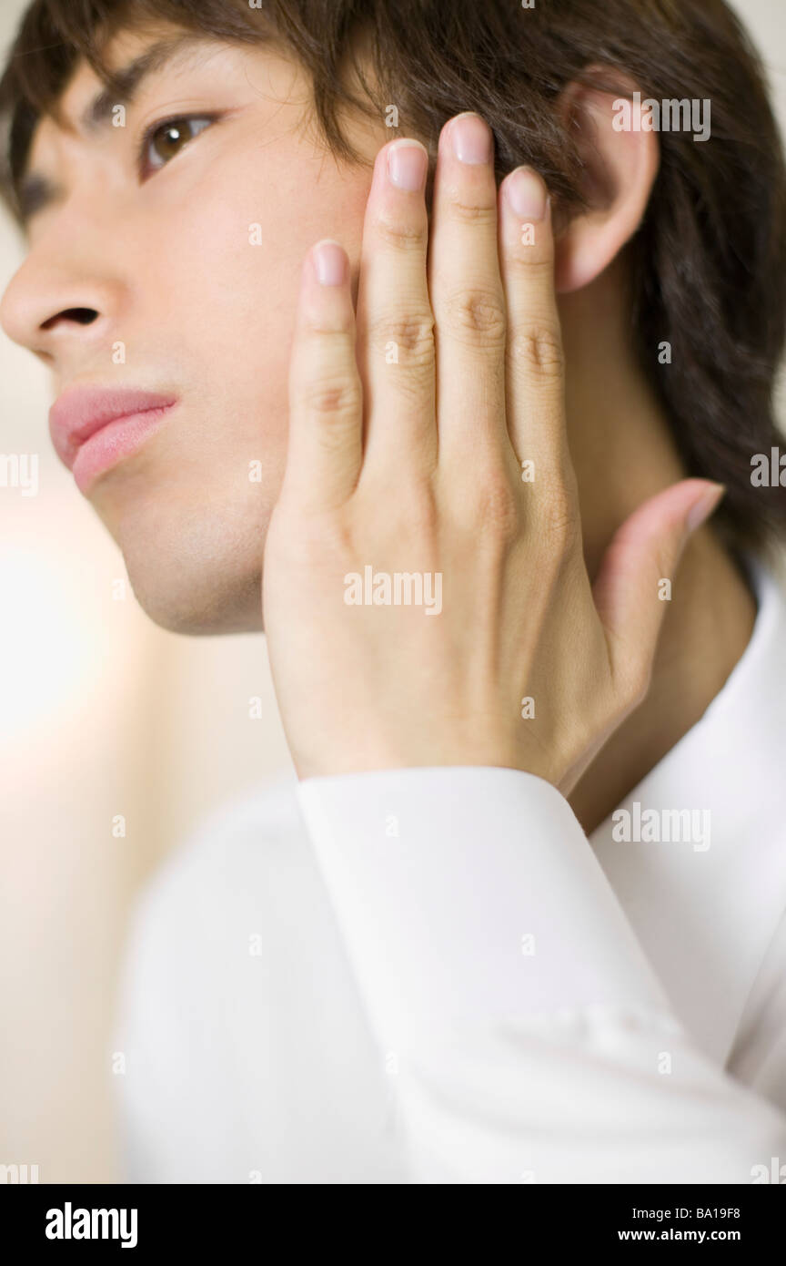 Young businessman worrying about his beards - Stock Image