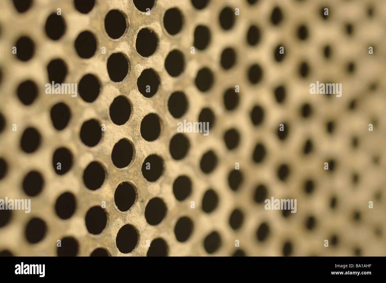 old brass metal mesh holes background texture - Stock Image