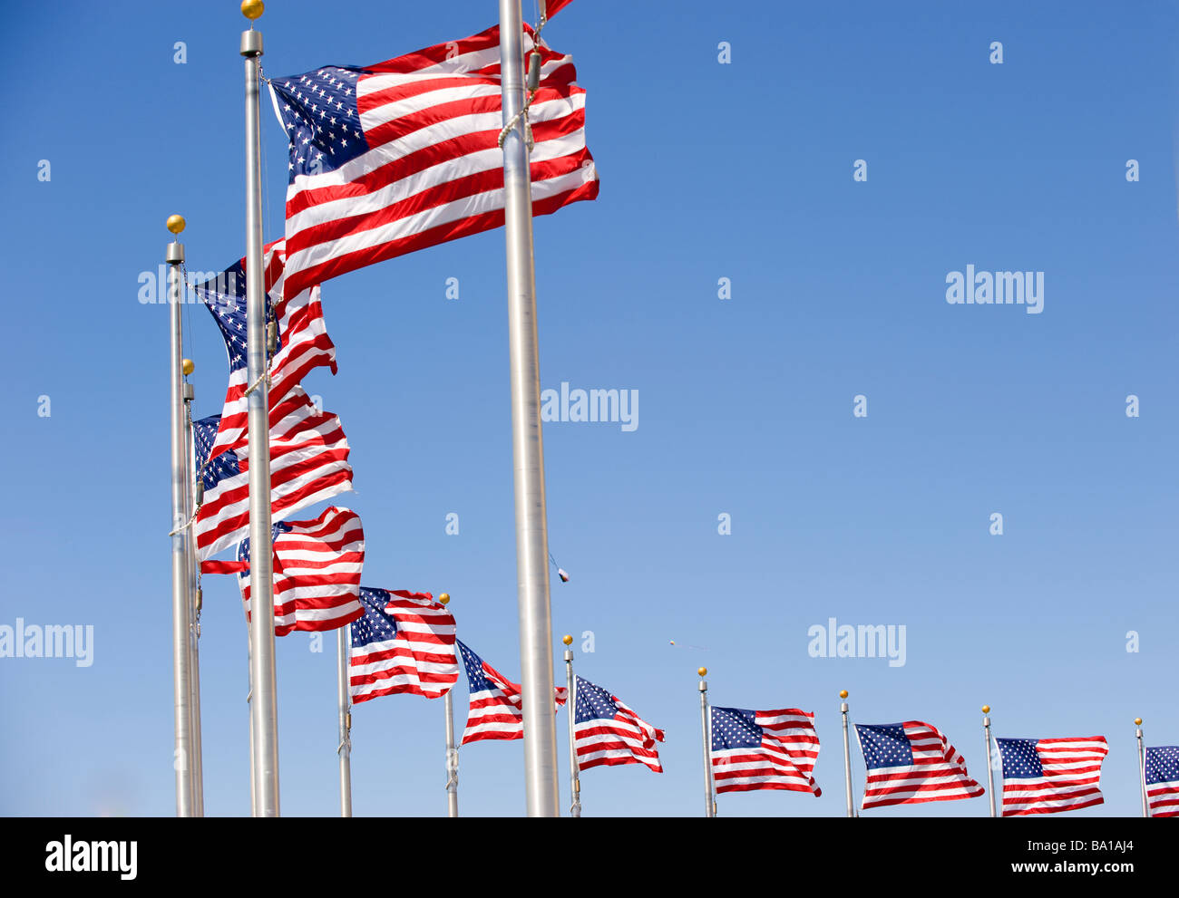 American flags at the Washington Monument form arc - Stock Image