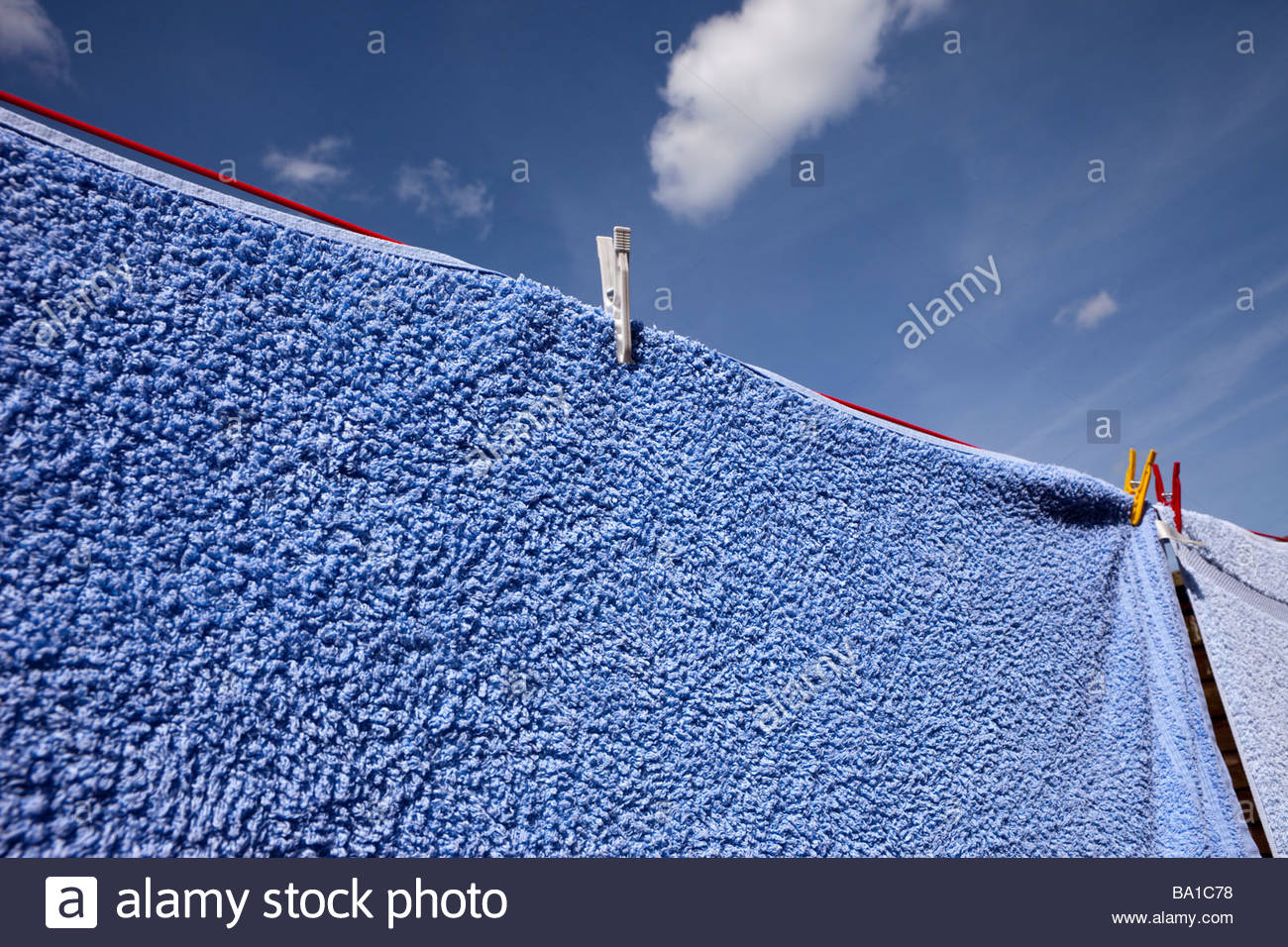Washing drying on a line - Stock Image