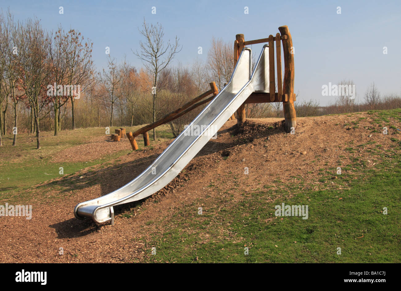 A children's slide in the children's play area in the Bedfont Lakes Country Park, Middx, UK. Stock Photo