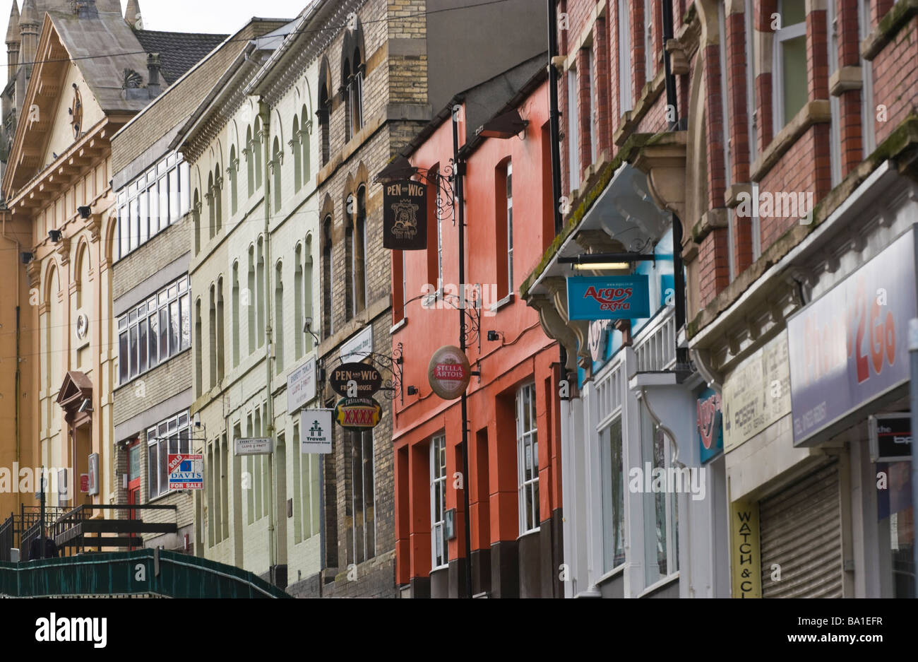 Victorian facade above modern shop fronts in Newport South Wales UK - Stock Image