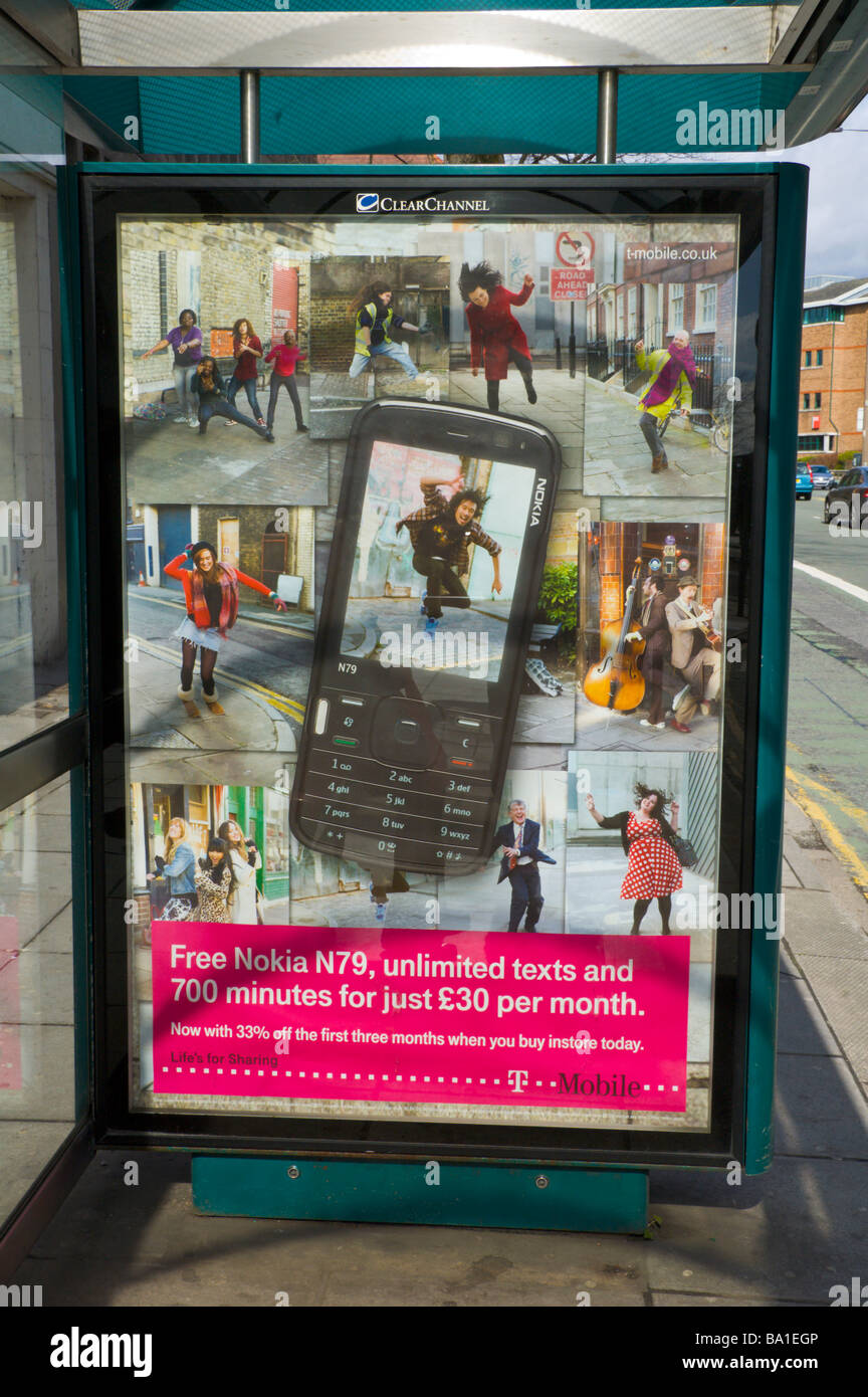 ClearChannel advertising billboard for T Mobile Nokia N79 mobile phone at bus shelter in Cardiff South Wales UK - Stock Image