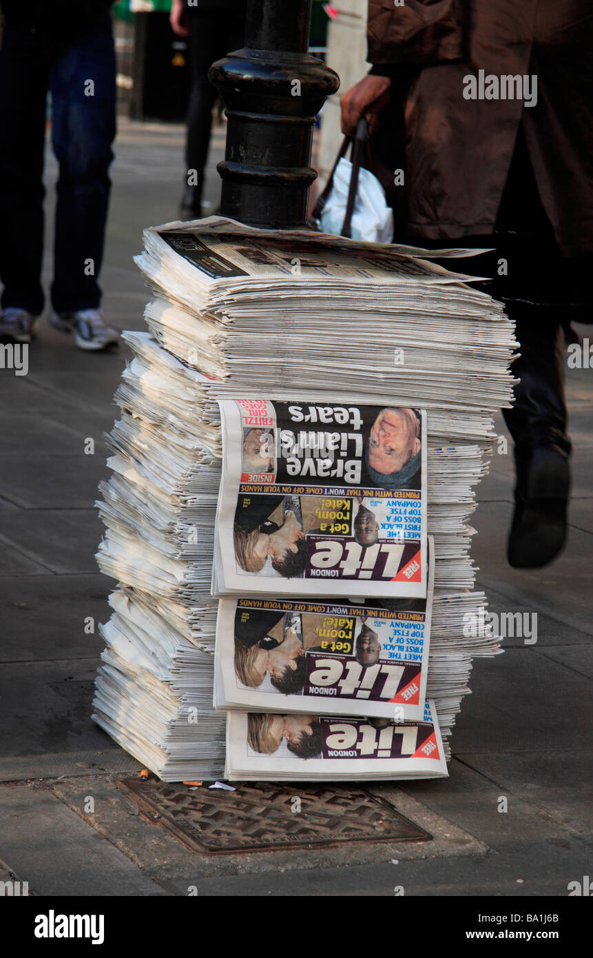 A large stack of the London Lite, one of several newspapers given away free during the evening rush hour in London, - Stock Image
