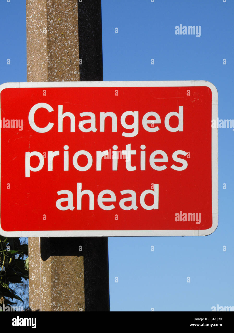 road signs - changed priorities - Stock Image