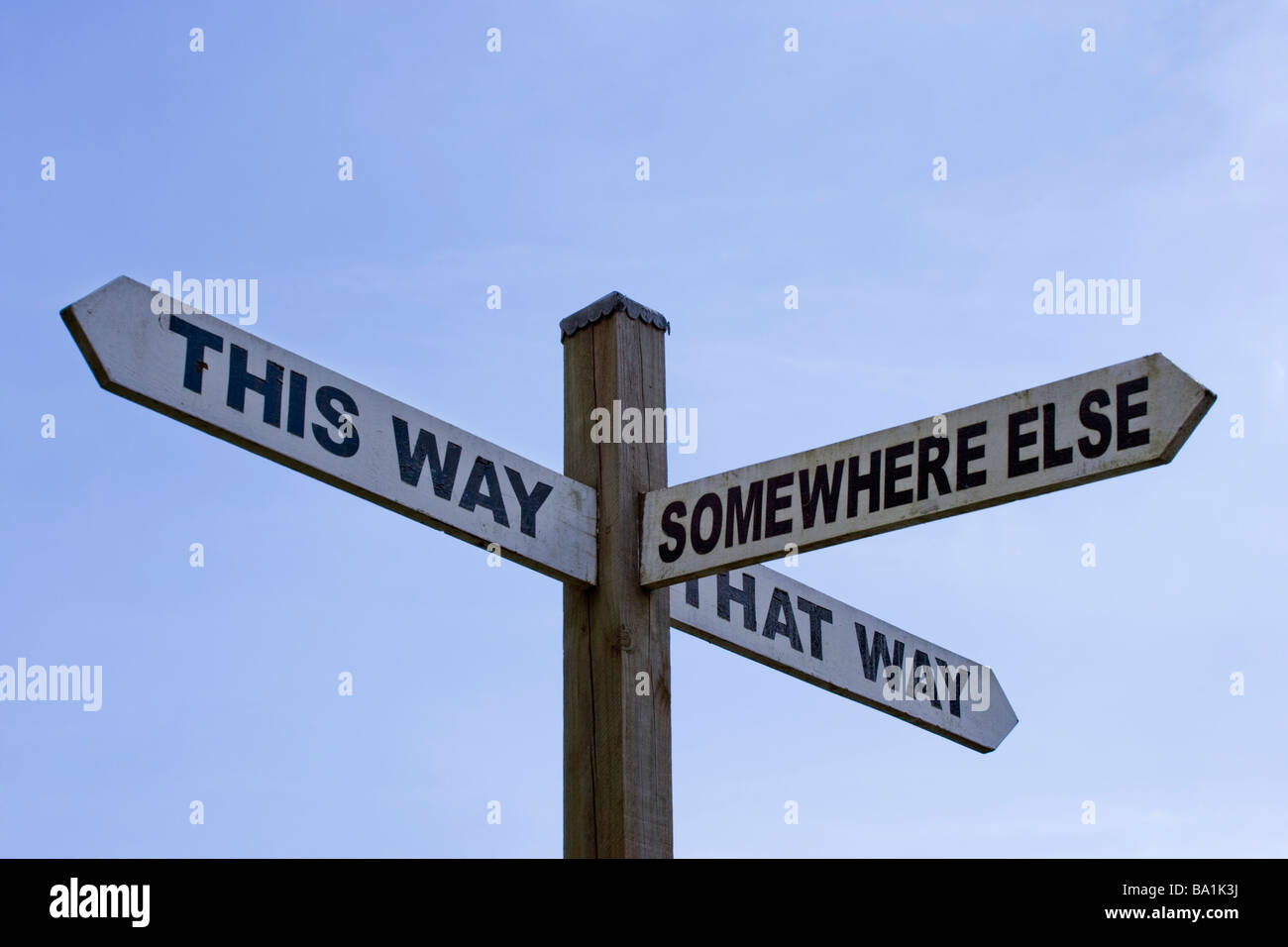 Humorous sign - This Way, That Way, Somewhere Else. Surrey, UK - Stock Image