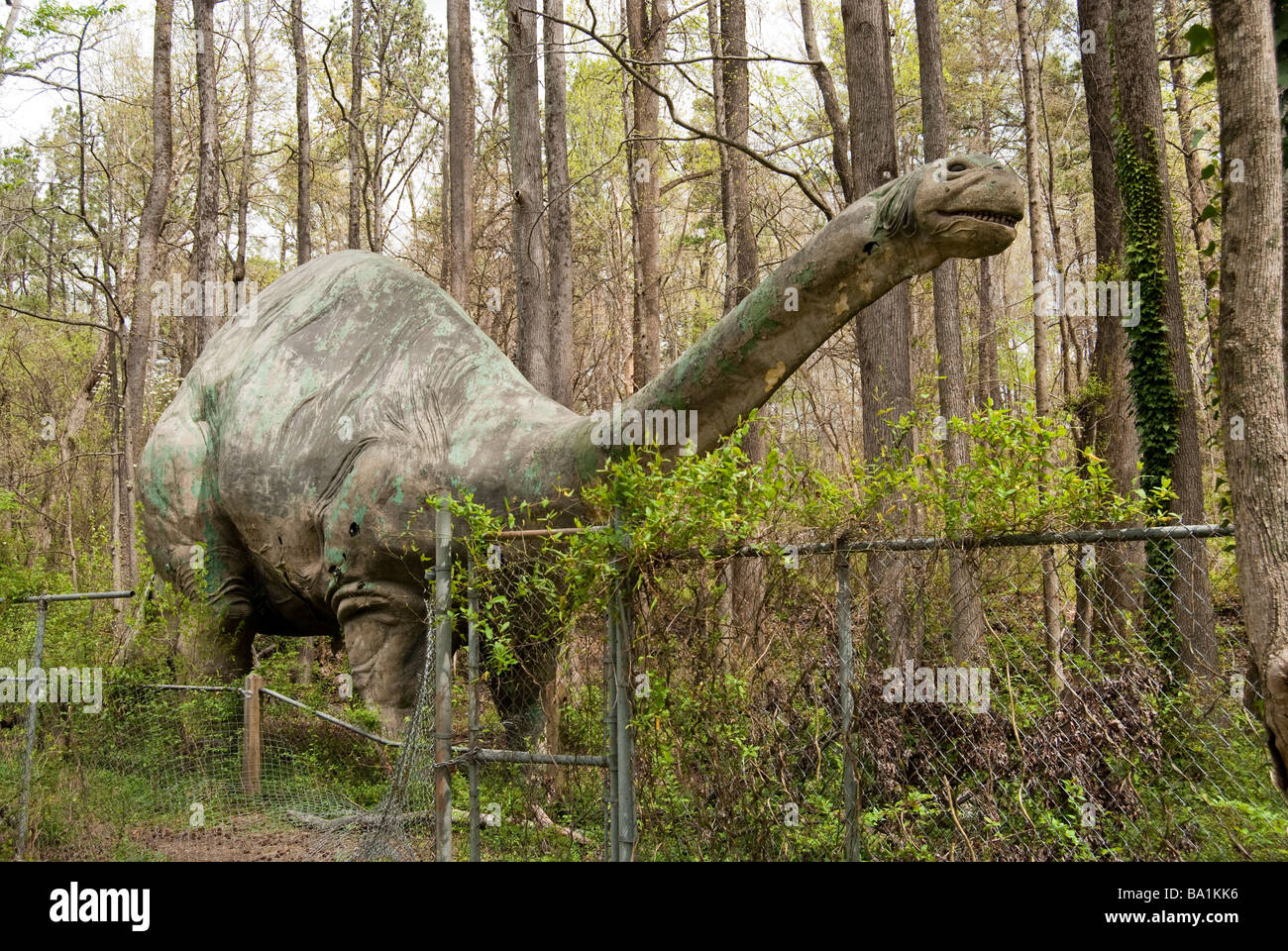 Neglected Statue of a Brontosaurus Dinosaur - Stock Image
