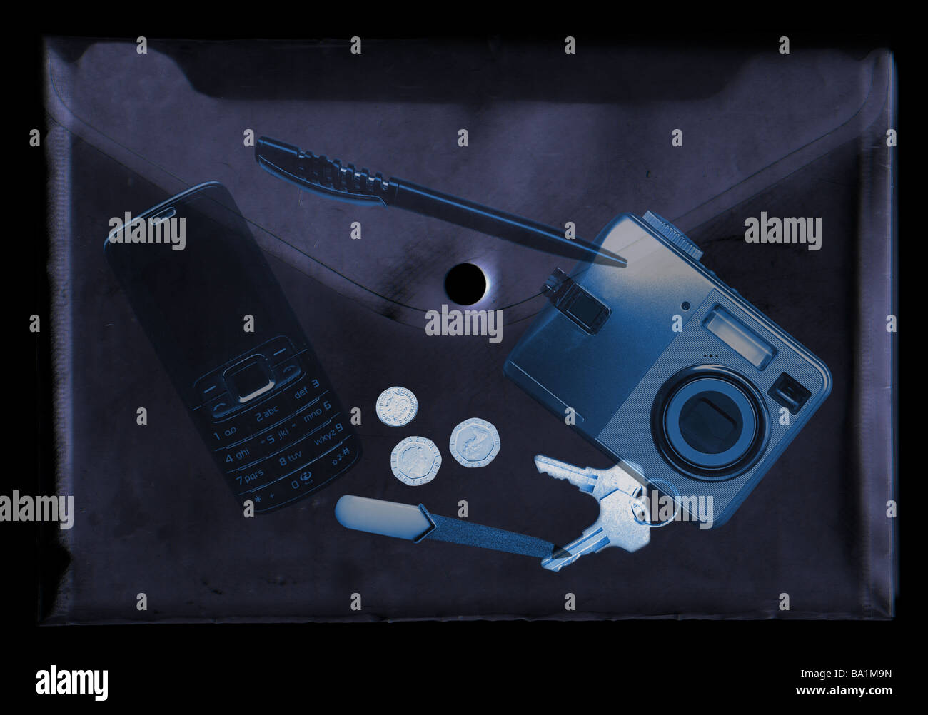 A montage of items in a bag as they would appear in an xray machine - Stock Image