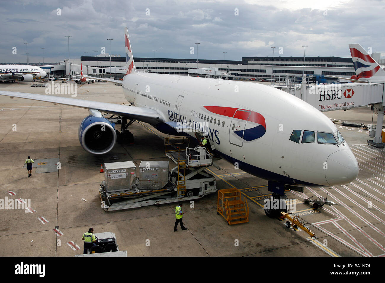 A British Airways Boeing 777-200 aircraft sits on the tarmac at Sydney Kingsford Smith International Airport - Stock Image