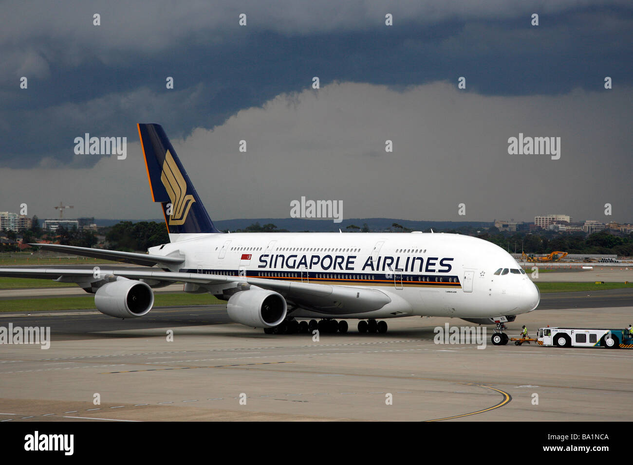 A Singapore Airlines Airbus A380 Superjumbo aircraft sits on the tarmac at Sydney Kingsford Smith International - Stock Image