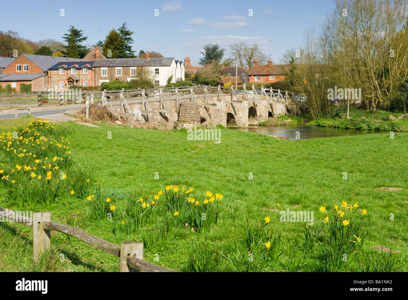 Tilford, Surrey, UK. Bridge over River Wey. - Stock Image