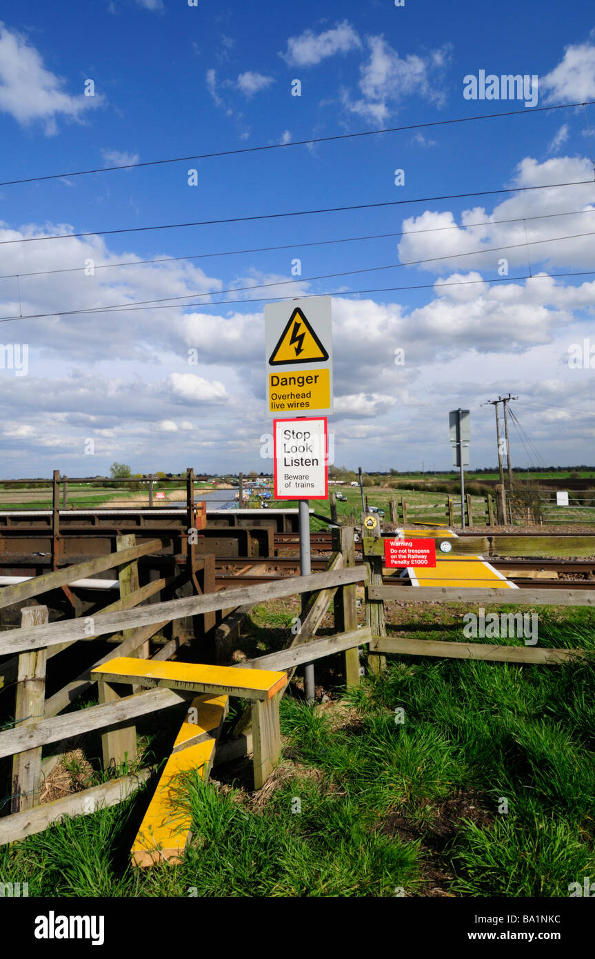 A stile leading to a  footpath over railway lines at a bridge over the Great Ouse near Stretham Cambridgeshire England - Stock Image