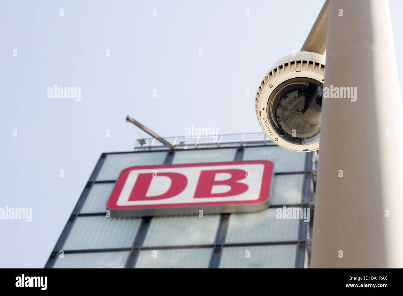 Surveillance camera and logo of the Deutsche Bahn AG at the central station - Stock Image