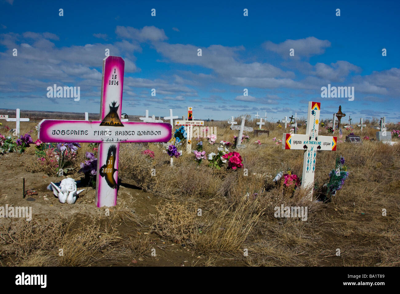 Wooden grave markers at a rural indian cemetery Fort Belknap Reservation near Harlem Montana - Stock Image