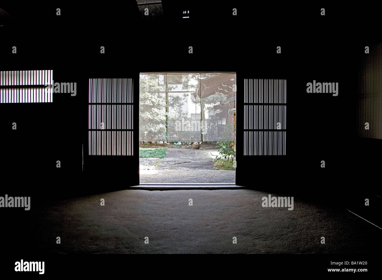 Open Door of House with Earthen Floor - Stock Image