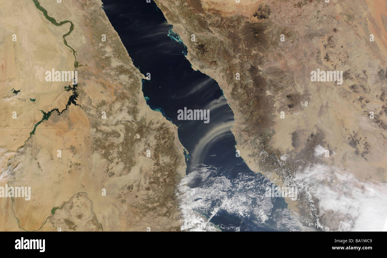 Dust plumes blow off the coast of Saudi Arabia and over the Red Sea - Stock Image
