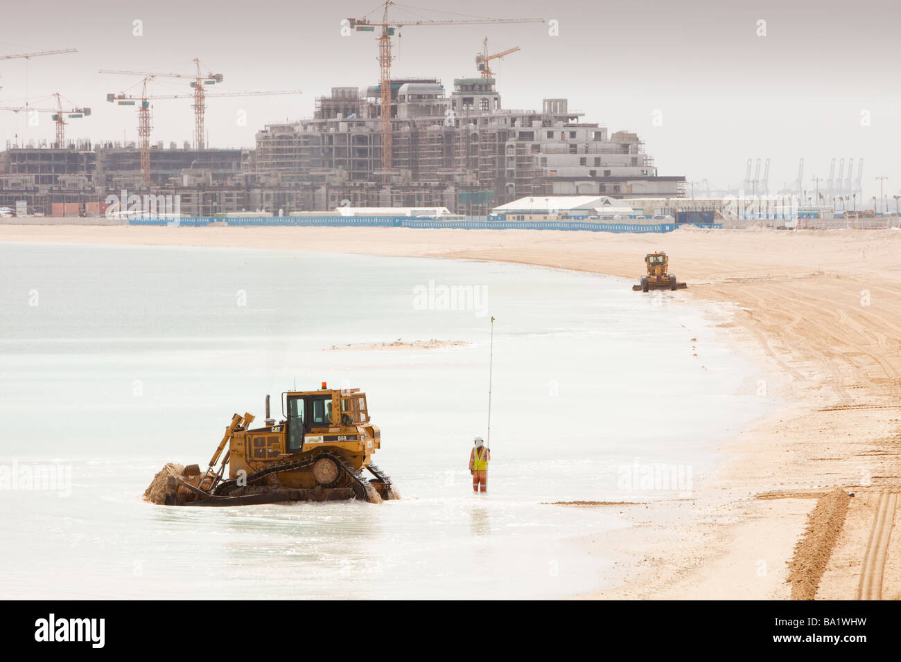 Constructing a new beach reclaimed from the sea on the Palm in Dubai,UAE Stock Photo