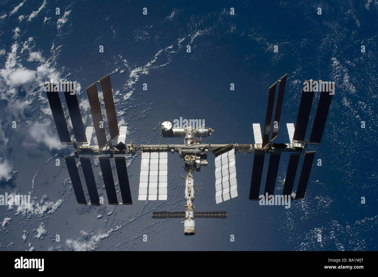 March 25, 2009 - The International Space Station, backdropped by a blue and white Earth. - Stock Image