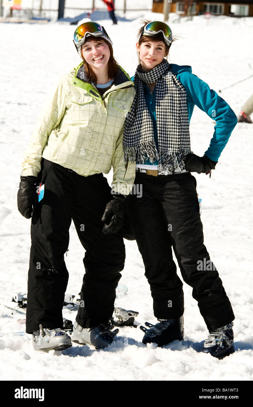 Two beautiful fashionable girls dressed in ski suits - Stock Image