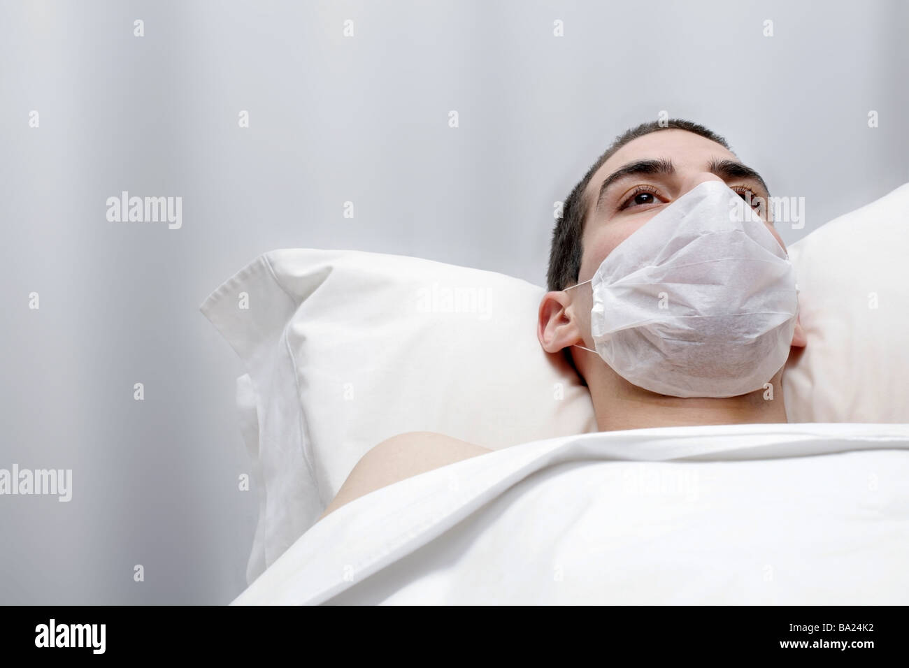 young male patient waiting for doctor healthcare - Stock Image