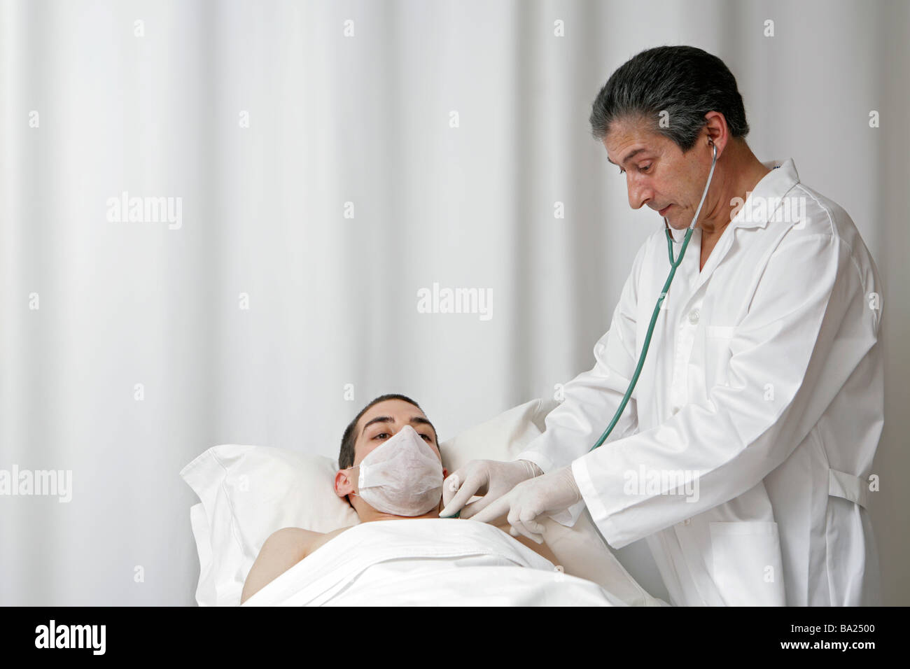 young male patient is being observed by doctor for health treatment - Stock Image