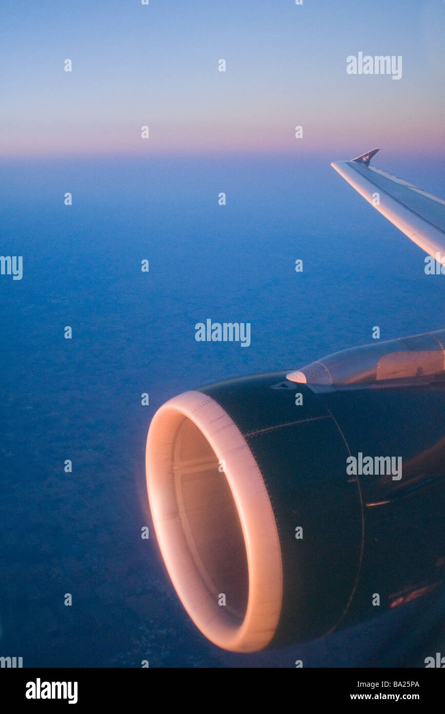 Jet engine on commercial airliner in flight - Stock Image