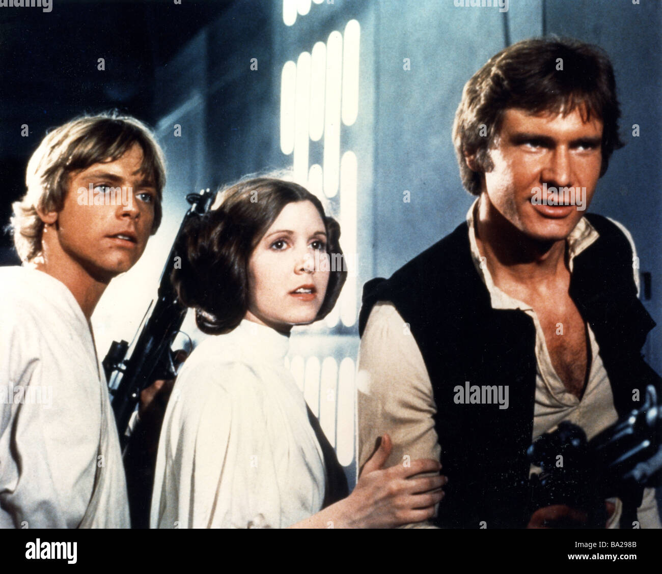 STAR WARS : EPISODE IV - A NEW HOPE 1977 TCF film with from left: Mark Hamill, Carrie Fisher and Harrison Fiord - Stock Image