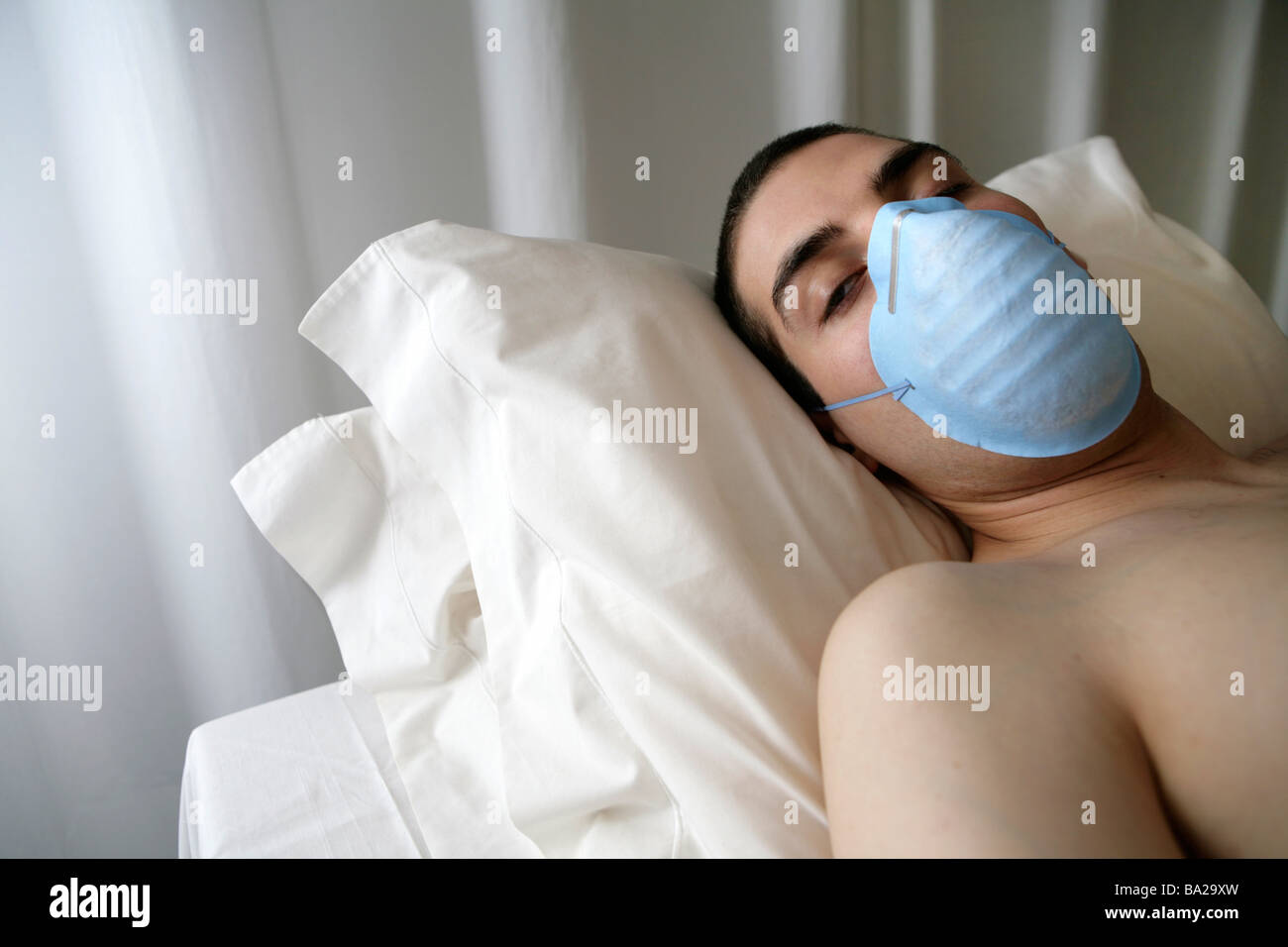 Adult male patient with mask waiting for doctor health - Stock Image