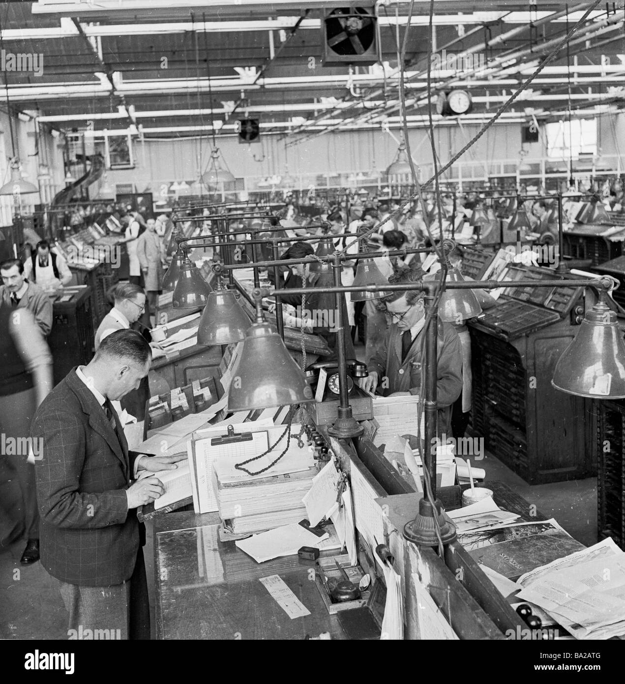 General view of the typesetting room at the HMV print factory England 1950s - Stock Image