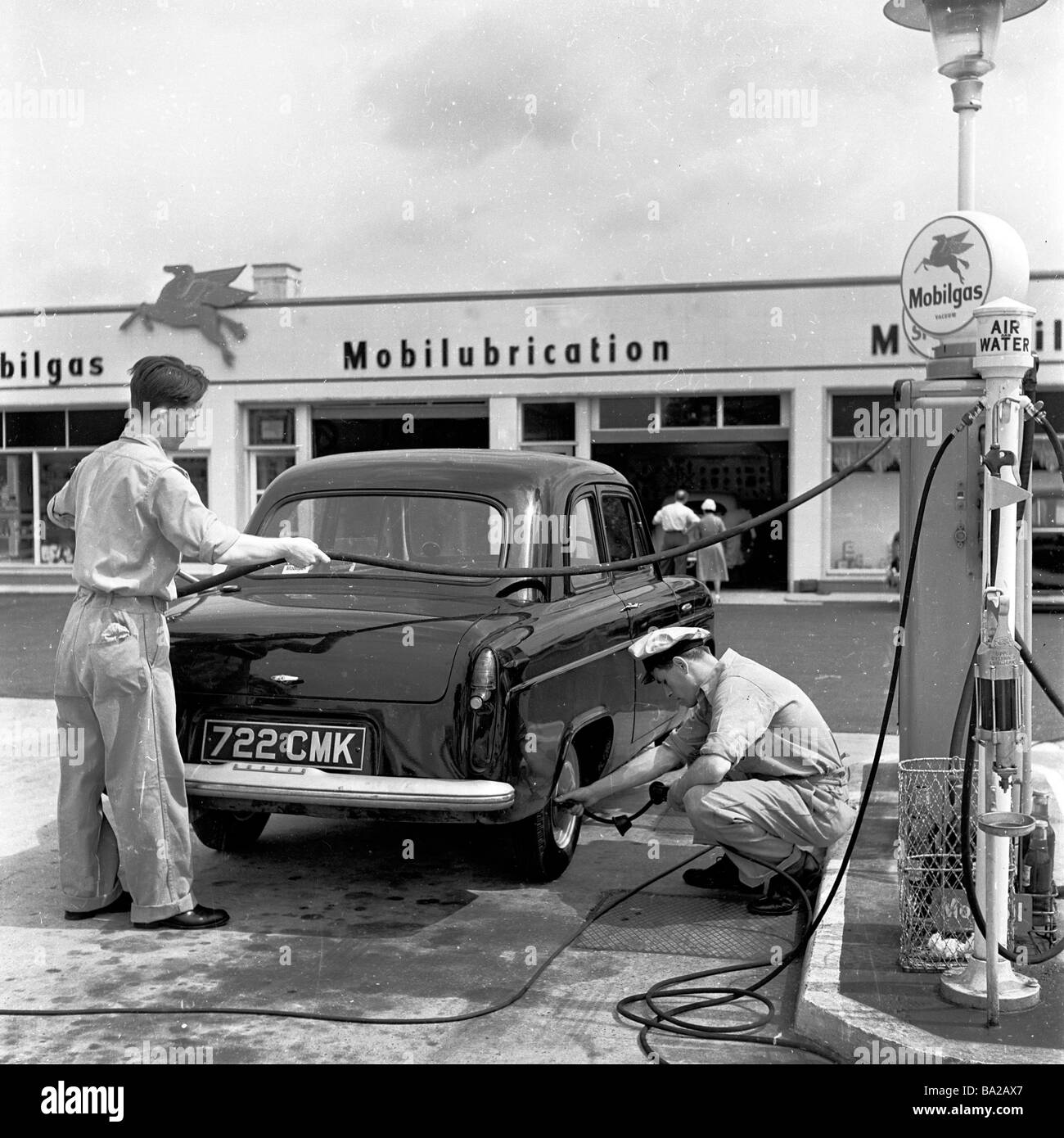 Garage Or Gas Station Attendants Service A Car Mobilgas