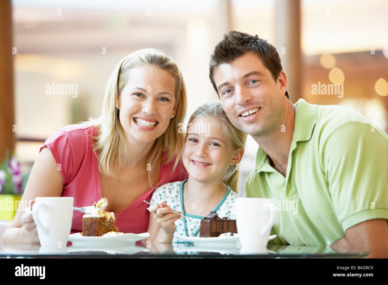 Family Having Lunch Together At The Mall Stock Photo