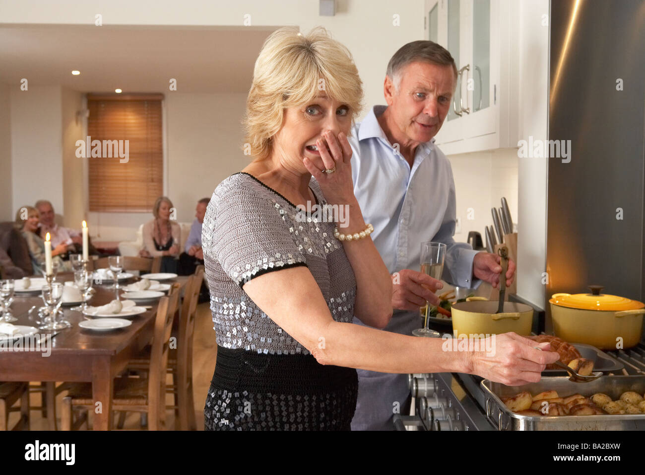 Couple Having Difficulty Cooking For A Dinner Party - Stock Image