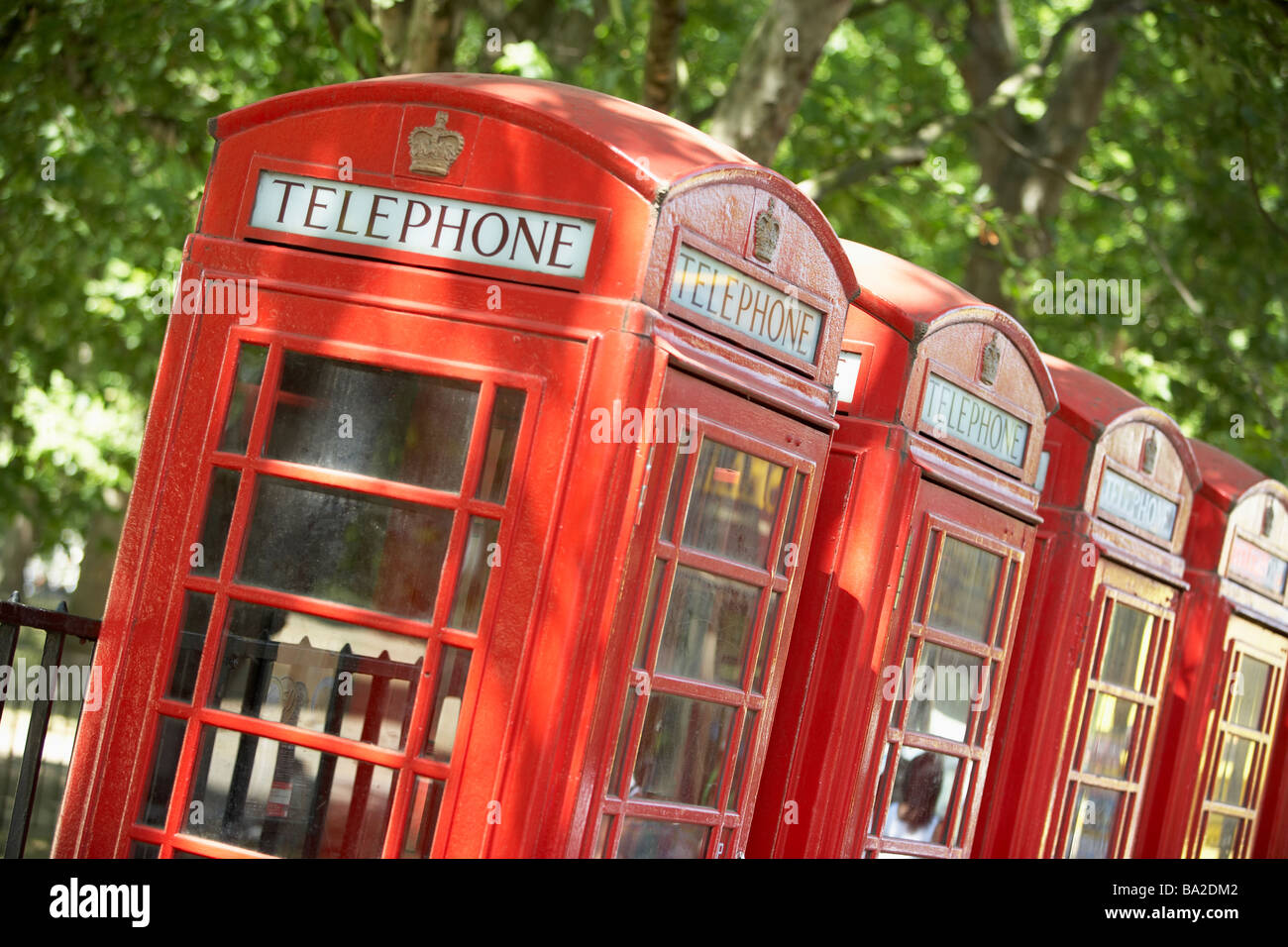 Red Telephone Booths In A Row - Stock Image