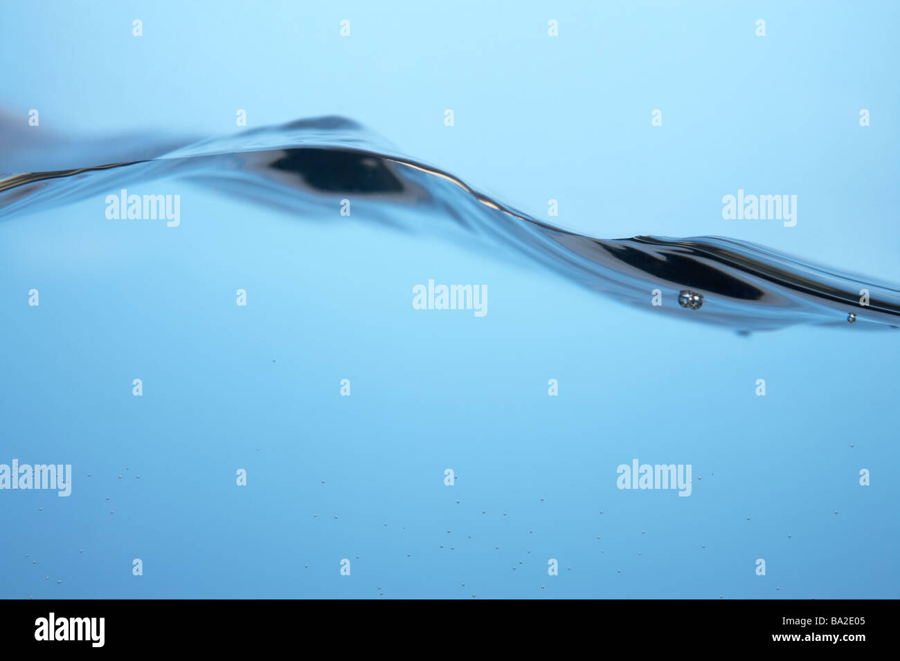 Water Rippling Against Glass - Stock Image