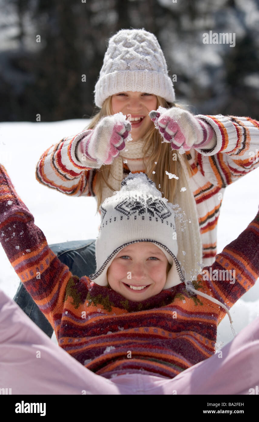 Girls caps winter-clothing boisterously rant snow winters leisure time vacation winter-vacation vacation winter - Stock Image