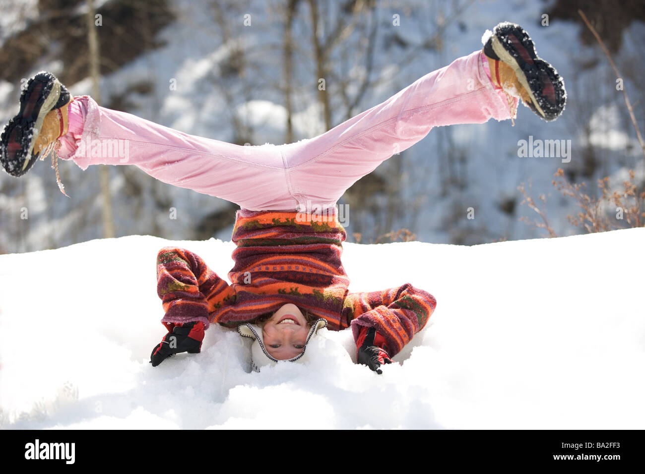 Girls cap winter-clothing headstand snow omitted winters leisure time vacation winter-vacation vacation winter-vacation - Stock Image