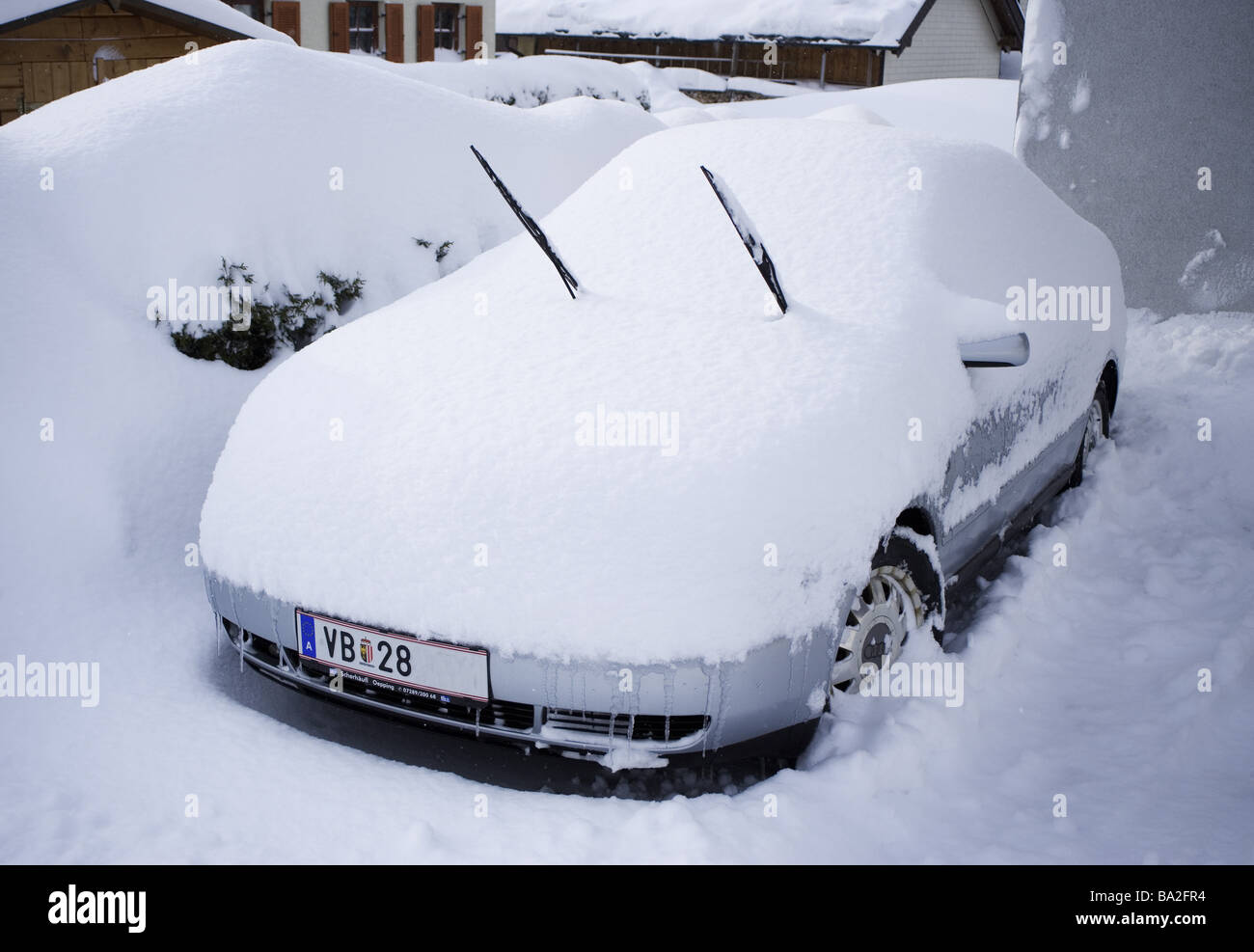 Parked parking place car gotten snowed in winters marks please unrecognizable does Stellplatz vehicle private car - Stock Image