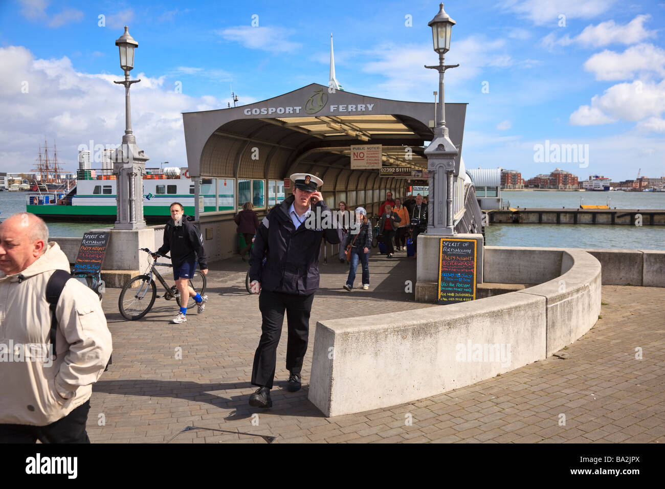 A Sailor on a mobile phone embarking at Gosport from the Porstmouth Ferry Stock Photo