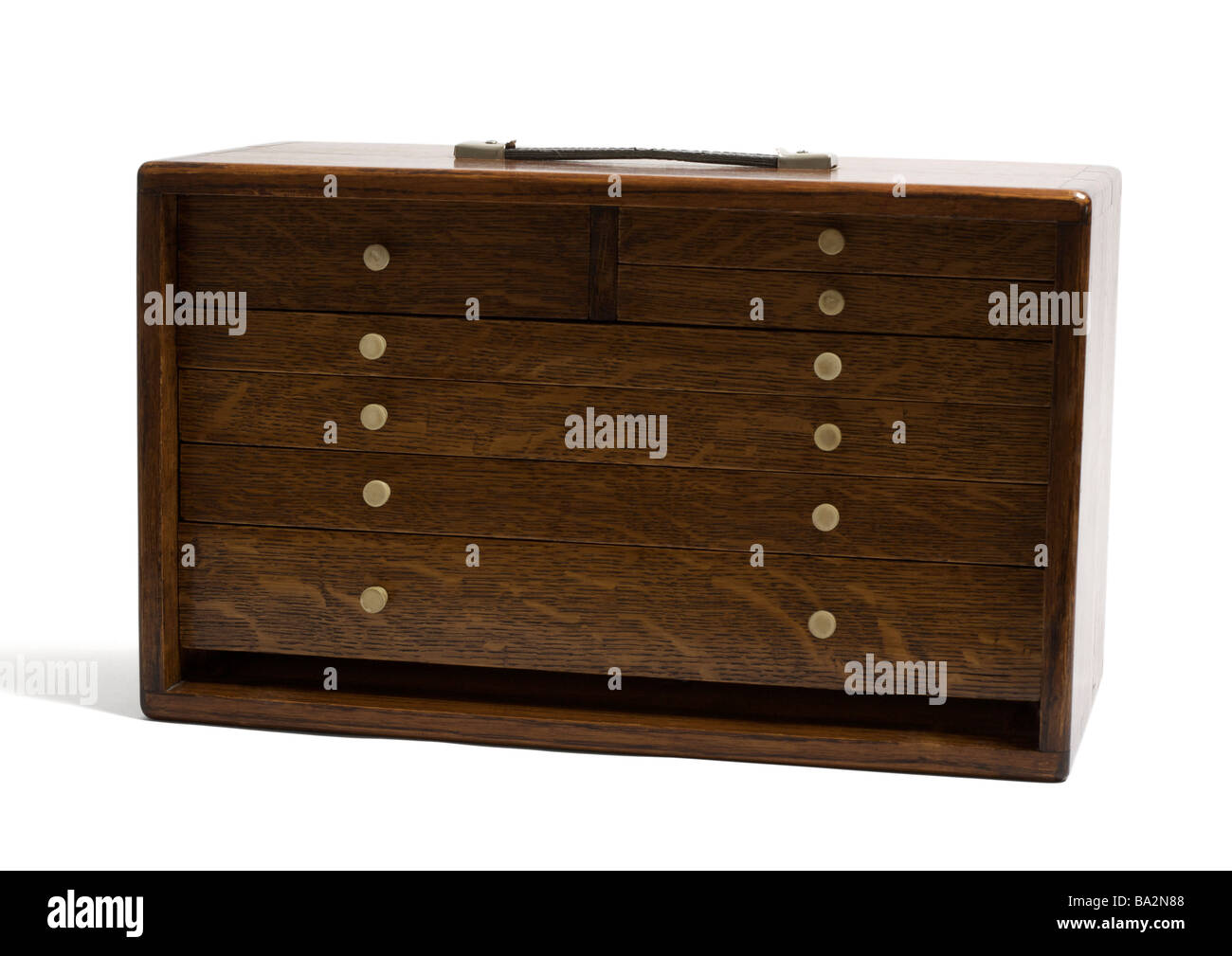 Wooden box with drawers on white background - Stock Image