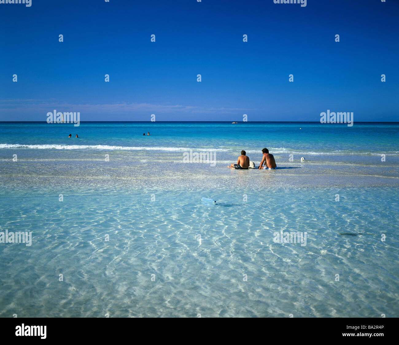 Caribbean swimmers models no release sea tourists water cooling bath-fun relaxen water refreshment sits enjoys leisure - Stock Image