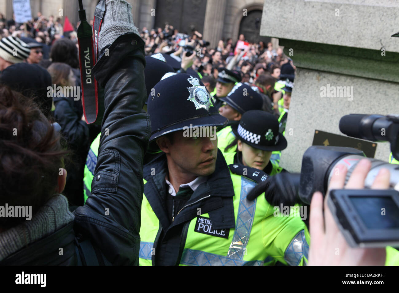 police lined up stopping protesters during the g20 protests in london. they are preventing protesters leaving the - Stock Image