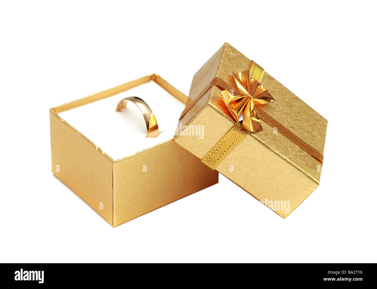golden ring in gift box isolated on white - Stock Image