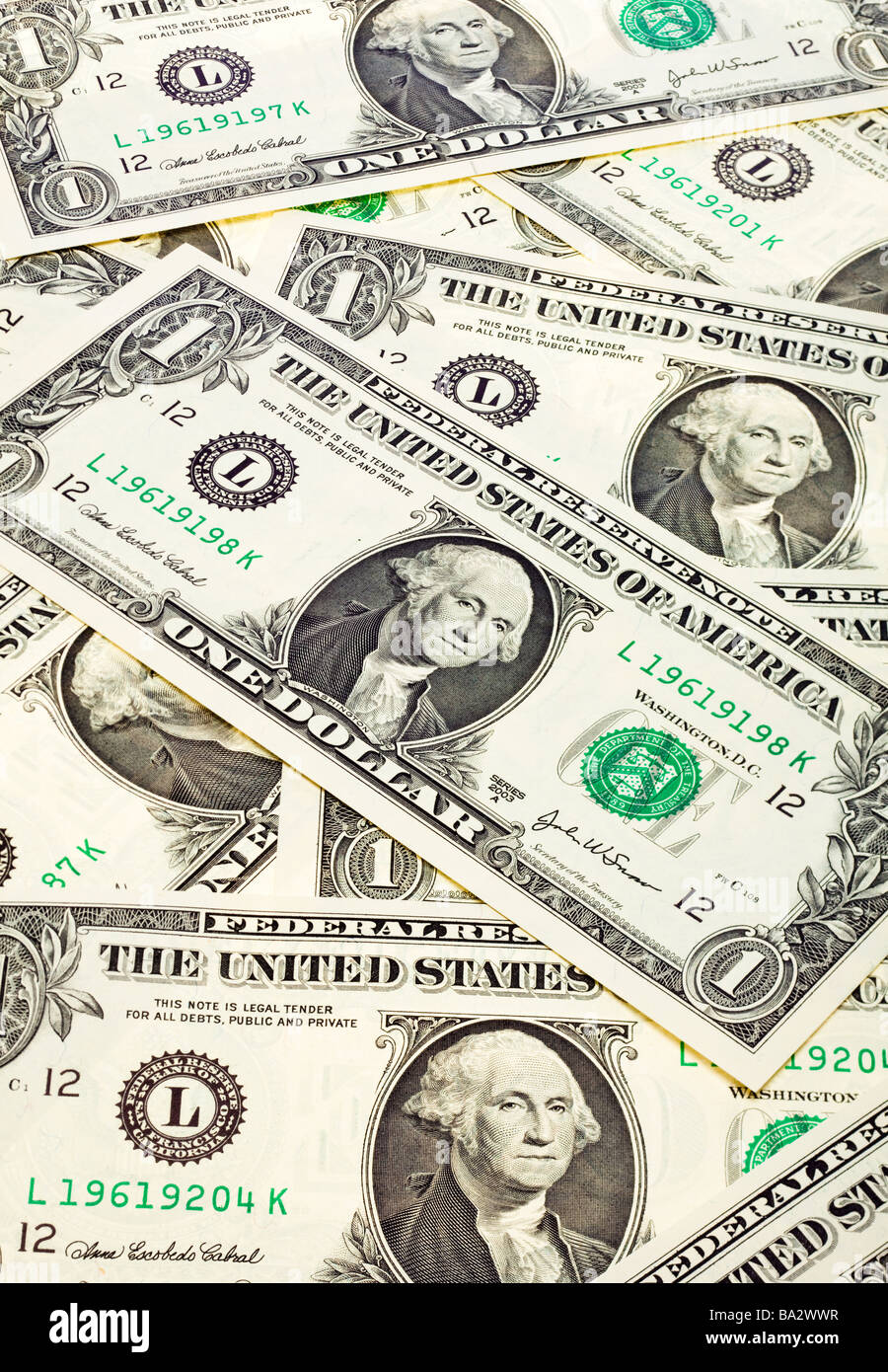 Group of US One Dollar bills laid flat - Stock Image