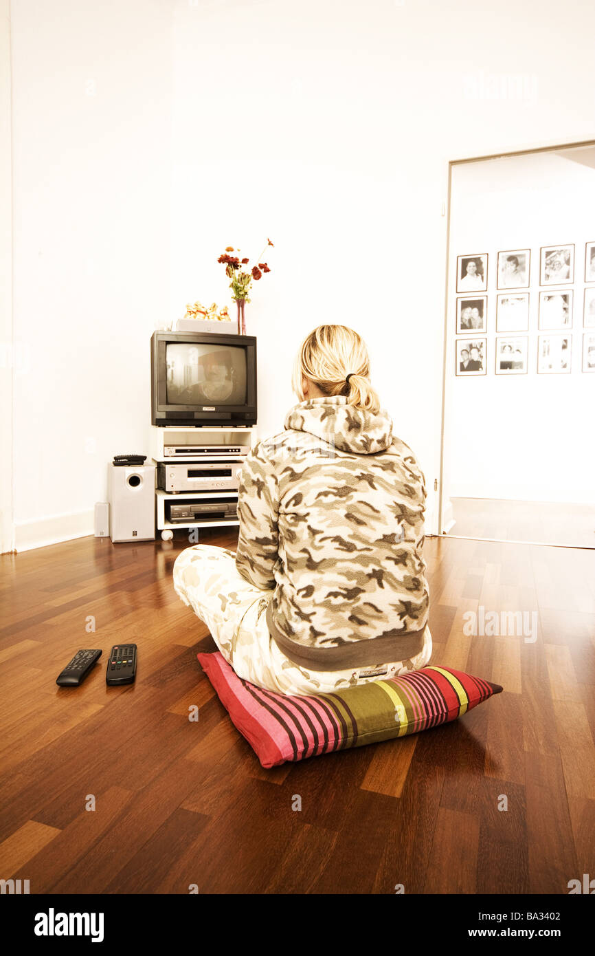 Sits woman young cushions floor back-opinion television-shows people ...