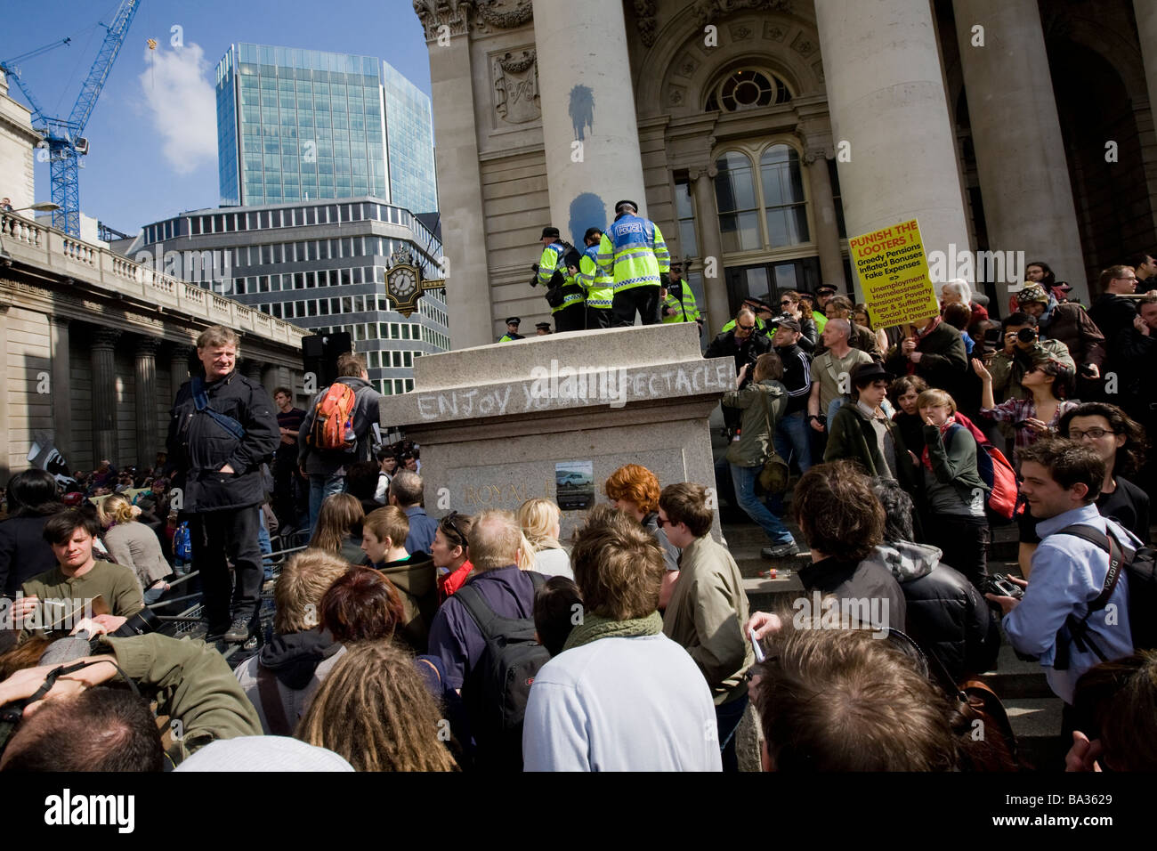 Police watch crowds from above at the G20 protest at Bank of England - Stock Image