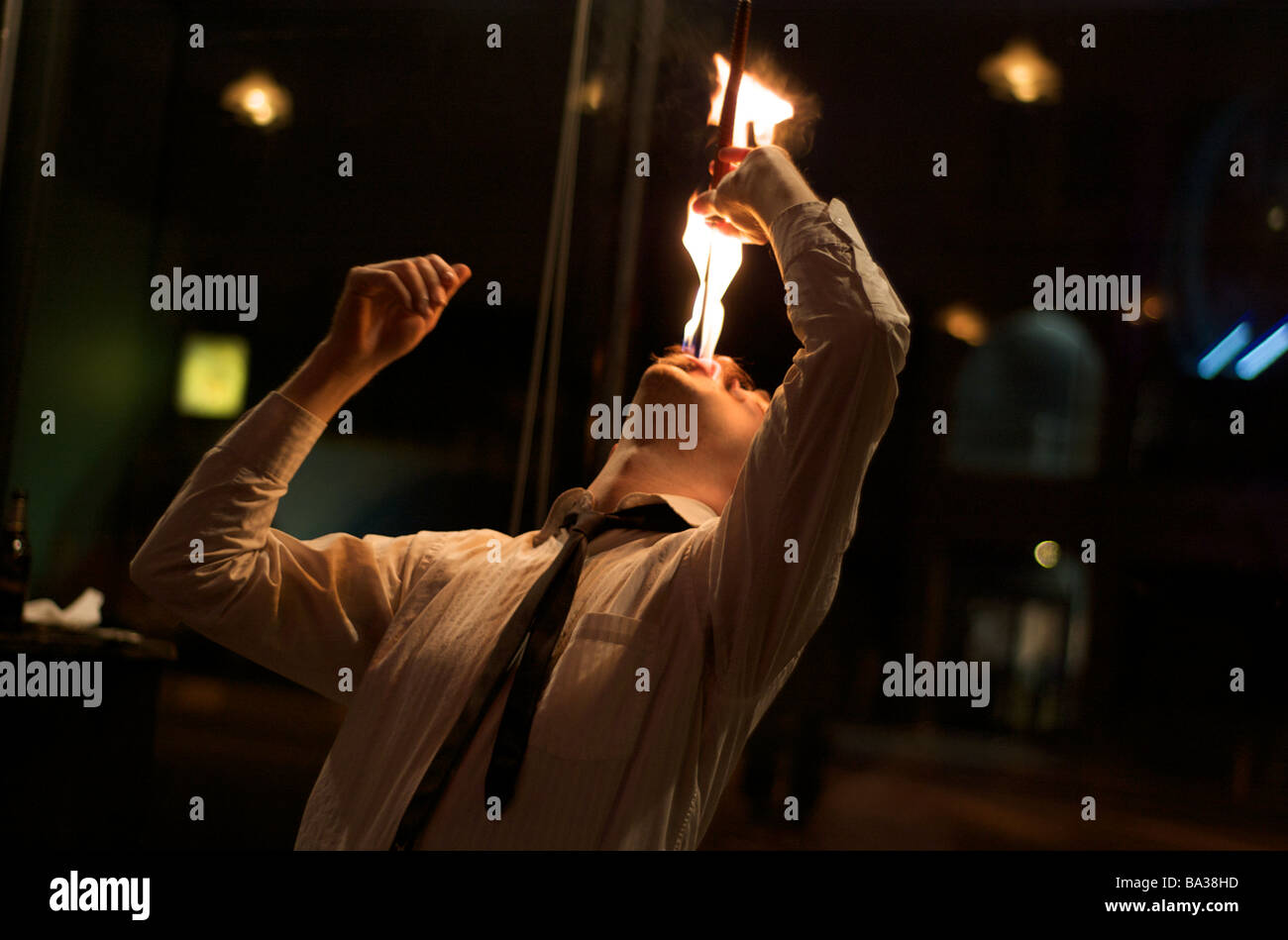 Male Fire Eater Performance in Coney Island, New York (For Editorial Use Only) - Stock Image