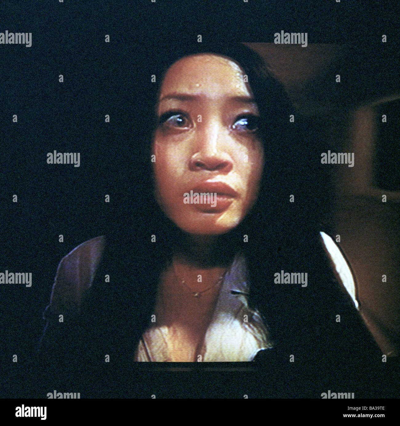 Television-program film woman Asian fear cries portrait no models release Asia China television startled program - Stock Image